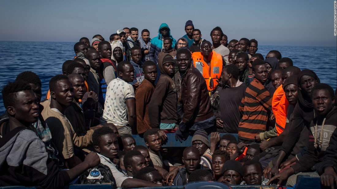 "Migrants wait to be rescued from a small wooden boat off the coast of Lampedusa, Italy, on Thursday, May 18. <a href=""http://www.cnn.com/2015/09/03/world/gallery/europes-refugee-crisis/index.html"" target=""_blank"">Europe's migration crisis in 25 photos</a>"