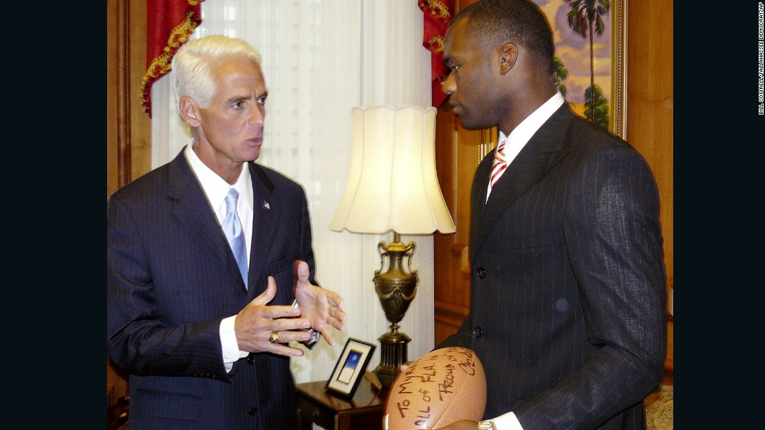 "Florida Gov. Charlie Crist presents Rolle with an autographed football inscribed ""To Myron -- All Fla. is proud of you,"" in 2008."