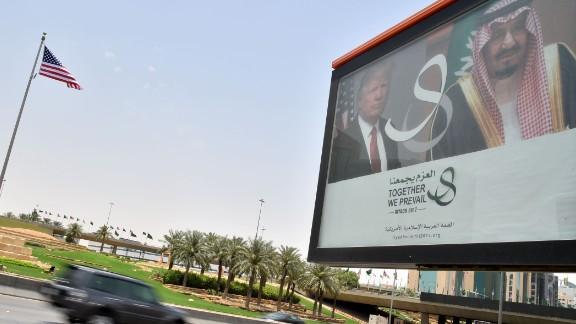 A giant billboard bearing portraits of President Donald Trump and Saudi Arabia