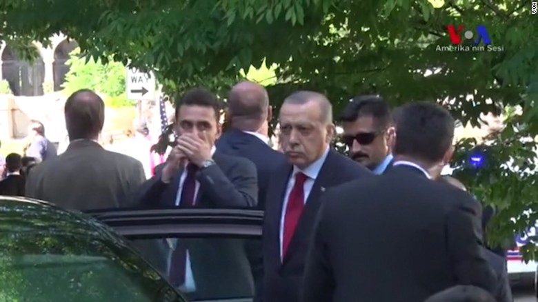Erdogan watches brawl outside Turkish embassy