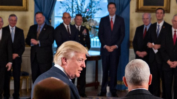"""WASHINGTON, DC - JANUARY 22: U.S. President Donald Trump (L) speaks next to U.S. Vice President Mike Pence during an Inaugural Law Enforcement Officers and First Responders Reception in the Blue Room of the White House on January 22, 2017 in Washington, DC. Trump today mocked protesters who gathered for large demonstrations across the U.S. and the world on Saturday to signal discontent with his leadership, but later offered a more conciliatory tone, saying he recognized such marches as a """"hallmark of our democracy."""" (Photo by Andrew Harrer-Pool/Getty Images)"""