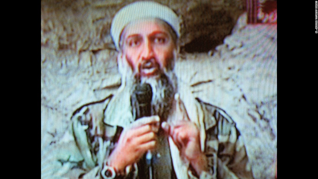 "Al Qaeda leader Osama bin Laden is seen at an undisclosed location in this television image broadcast on October 7, 2001. Bin Laden praised God for the Sept. 11 attacks and swore America ""will never dream of security"" until ""the infidel's armies leave the land of Muhammad."""
