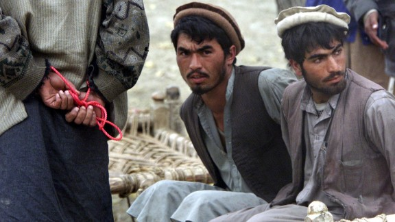 Al Qaeda prisoners are held in Agom, Afghanistan, on December 17, 2001. Afghan militia leaders declared victory in the battle of Tora Bora and claimed to have captured al Qaeda's last base.