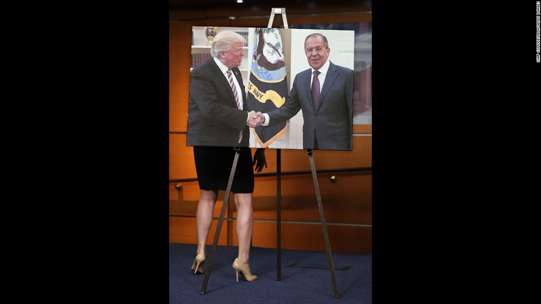 "During a news conference on Wednesday, May 17, House Democrats display a photo of President Trump shaking hands with Russian Foreign Minister Sergey Lavrov. The Democrats were calling for an independent commission that would investigate Russian interference in the 2016 election. Later in the day, the Justice Department <a href=""http://www.cnn.com/2017/05/17/politics/special-counsel-robert-mueller/"" target=""_blank"">appointed a special counsel,</a> former FBI Director Robert Mueller, to oversee a federal investigation. In a statement, Trump said an investigation will confirm that ""there was no collusion"" between his campaign and Russia."