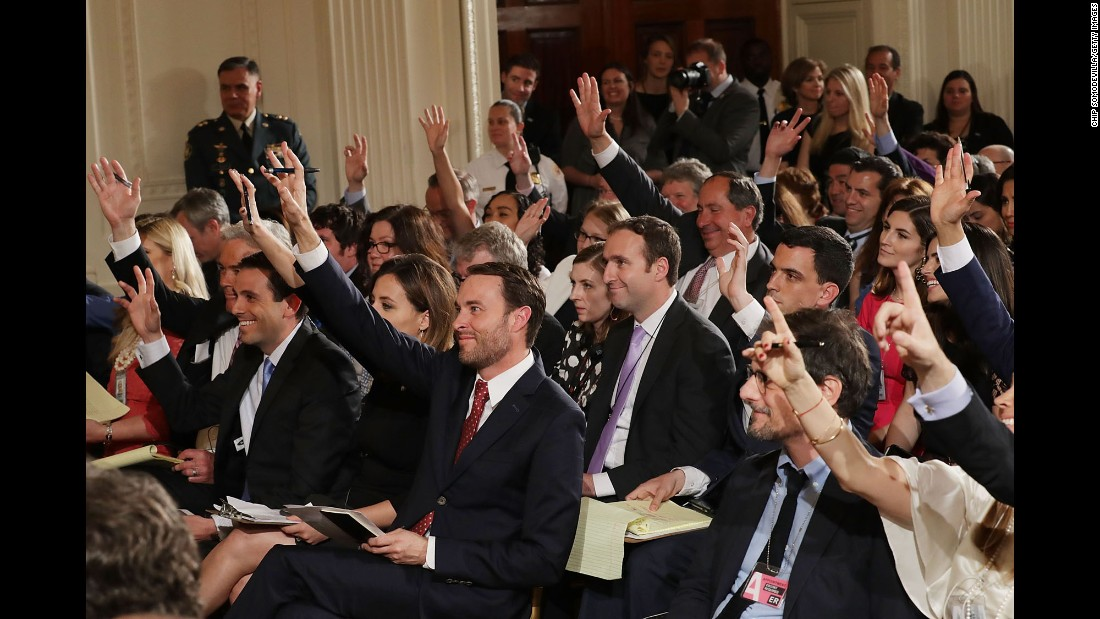 Reporters raise their hands to ask questions during President Trump's news conference with Colombian President Juan Manuel Santos on Thursday, May 18.