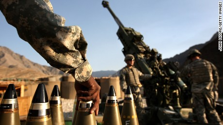 CAMP BLESSING, AFGHANISTAN - OCTOBER 22:  Artilerymen await coordinates before firing a 155mm Howlitzer on a Taliban position October 22, 2008 from Camp Blessing in the Kunar Province of eastern Afghanistan. Their unit, Charlie Battery, 3rd Battalion of the 321 Field Artilery, has fired more than 5,900 shells since it deployed to Afghanistan less than a year ago, making it the busiest artilery unit in the U.S. Army, according to to military officers. They most often fire in support of Army infantry units battling Taliban insurgents in the nearby Korengal Valley, site of some of the heaviest fighting in Afghanistan.  (Photo by John Moore/Getty Images)