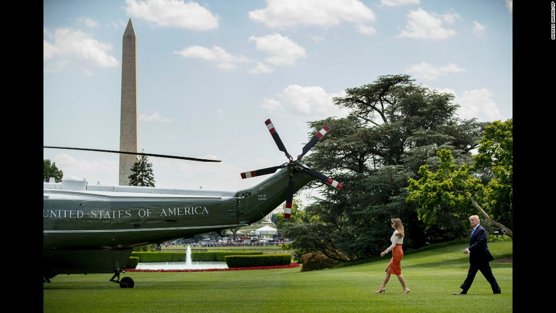 "President Trump and his wife, Melania, walk across the South Lawn of the White House to board Marine One on Friday, May 19. They were about to start a nine-day foreign tour -- <a href=""http://www.cnn.com/2017/05/19/politics/donald-trump-foreign-trip-preview/"" target=""_blank"">Trump's first as President.</a>"