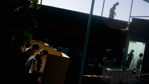 Afghan men cast their votes at a polling station in Kabul on August 20, 2009. It was the country's second election.