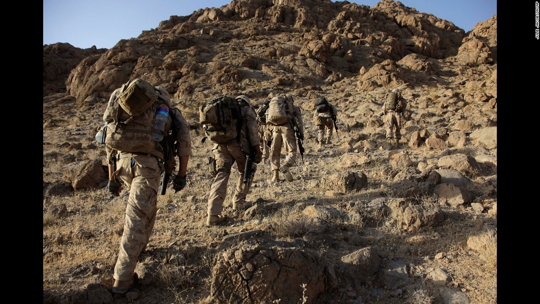 US Marines make their way up a mountainside in Afghanistan's Helmand Province on August 22, 2009.