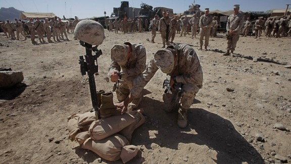 Marines pay their respects to Lance Cpl. Joshua Bernard during his memorial service in Helmand Province on August 27, 2009. Bernard was killed during a Taliban ambush earlier that month.
