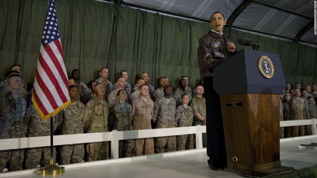 US President Barack Obama addresses troops at Bagram Air Base on March 28, 2010. A few months earlier, he announced a surge of 30,000 additional troops. This new deployment would bring the US total to almost 100,000 troops, in addition to 40,000 NATO troops.