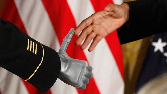 Obama shakes the prosthetic hand of Army Sgt. 1st Class Leroy Arthur Petry on July 12, 2011. Petry was at the White House to receive the Medal of Honor. The Army Ranger lost his hand while tossing an enemy grenade away from fellow soldiers in Afghanistan.
