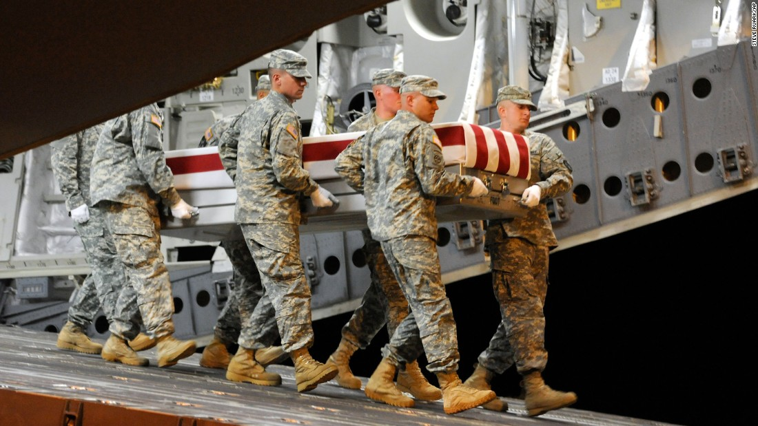A US Army carry team moves the remains of Sgt. William B. Gross Paniagua at Dover Air Force Base in Delaware on August 1, 2011. Gross Paniagua died in Afghanistan on July 31, 2011, from injuries sustained by an improvised explosive device.