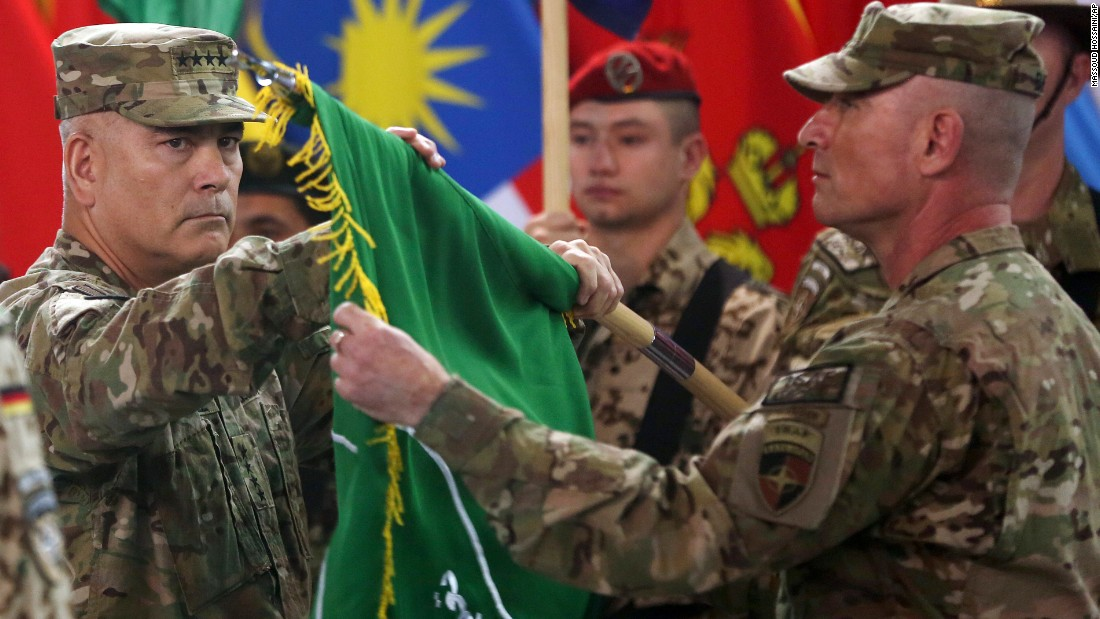 "US Army Gen. John Campbell, left, and Command Sgt. Maj. Delbert Byers open the ""Resolute Support"" flag during a ceremony in Kabul on December 28, 2014. The United States and NATO formally ended the combat mission in Afghanistan. Resolute Support was the name of the new mission to assist and train Afghanistan's troops."