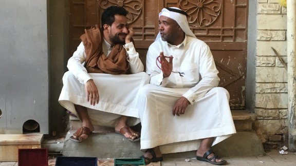 Two merchants sit with their goods in Riyadh