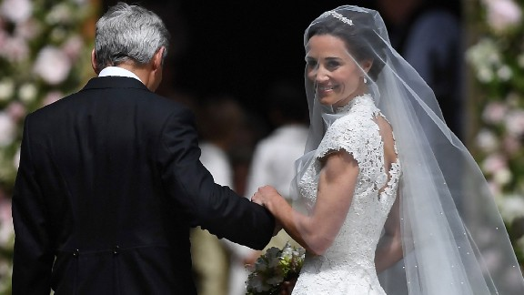 Pippa Middleton is escorted by her father Michael Middleton, as she arrives for her wedding to James Matthews at St Mark's Church in Englefield, west of London, on Saturday,  May 20.