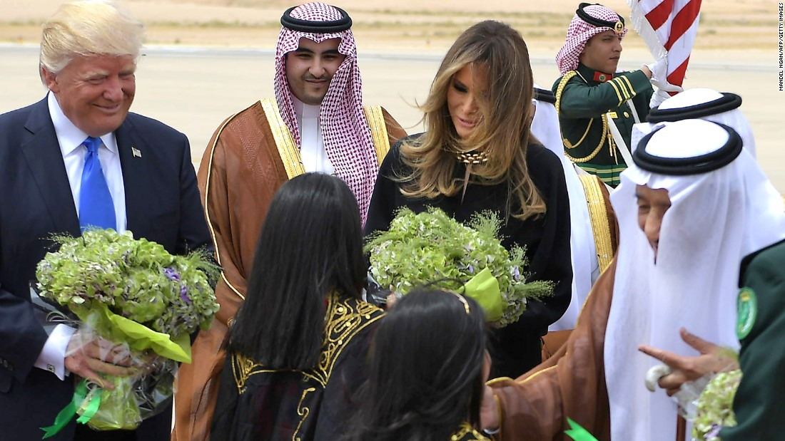 The Trumps take part in the welcome ceremony.
