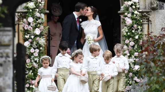 Pippa Middleton and James Matthews exit the church after their wedding ceremony at St. Mark's Church on Saturday, May 20, in Englefield, England.