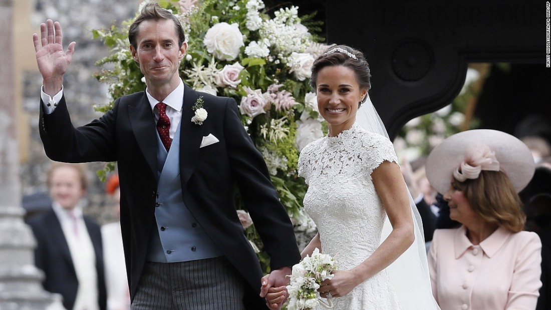 Pippa Middleton and James Matthews leave St. Mark's Church following their wedding.