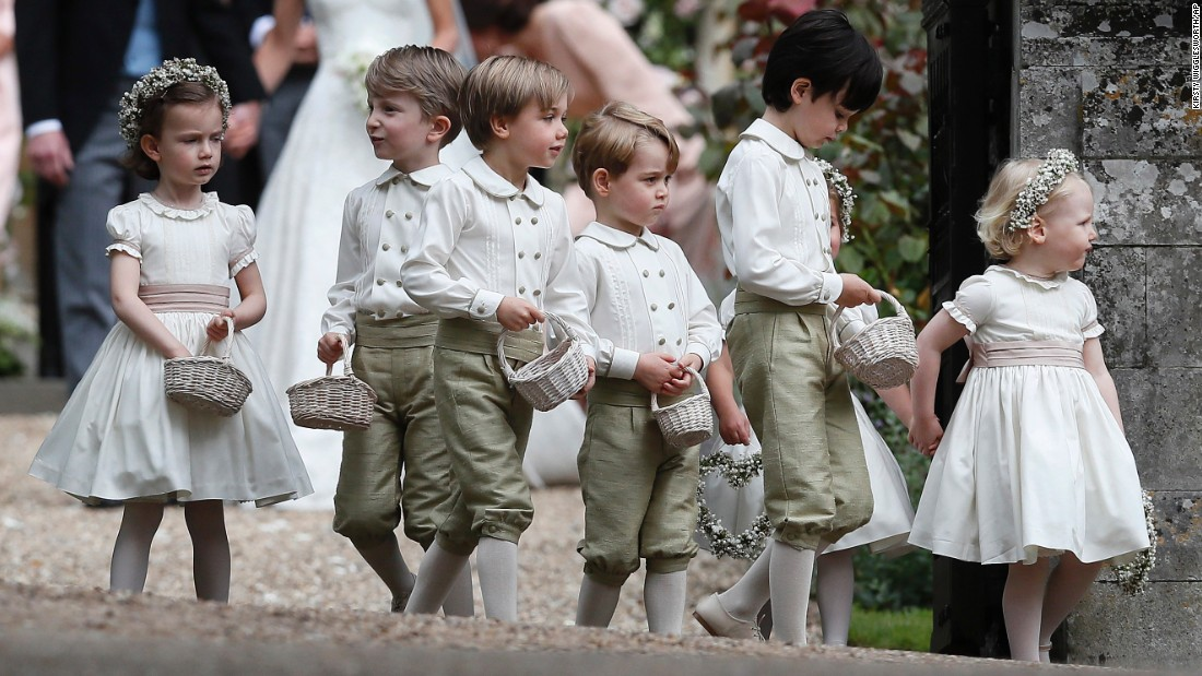 Prince George, fourth from the left, stands with other page boys and flower girls after the wedding.