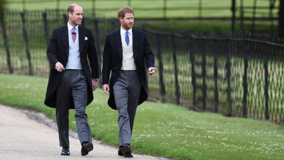 Prince William, Duke of Cambridge, and Prince Harry walk to the church.