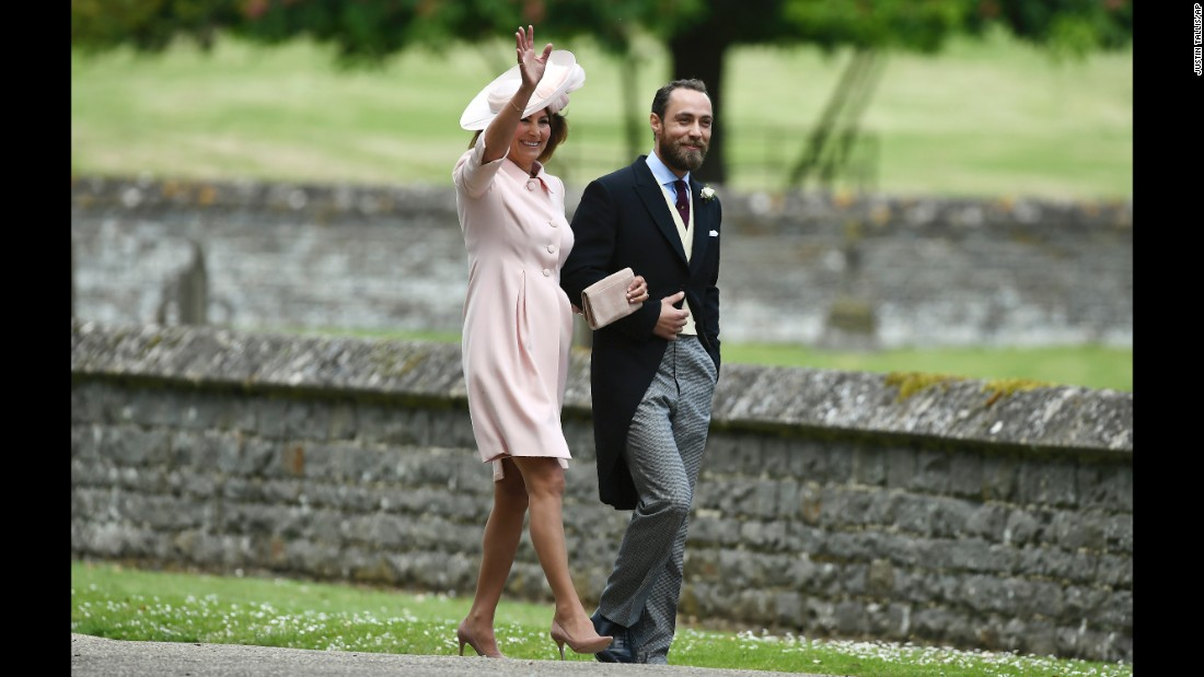 Carole Middleton and her son, James, arrive for the wedding of her daughter Pippa and James Matthews.