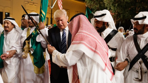 Trump is handed a sword during a welcoming ceremony at Riyadh