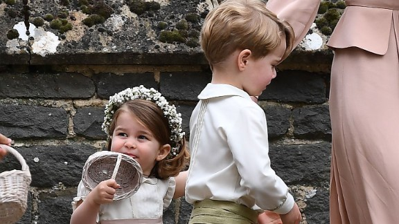 Catherine, Duchess of Cambridge, walks with her daughter, Princess Charlotte, a flower girl, and son, Prince George, following the wedding.