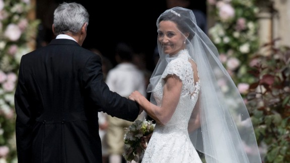 Pippa Middleton and her father, Michael Middleton, stand at St. Mark's Church before the ceremony.
