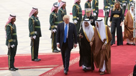 US President Donald Trump is welcomed by Saudi King Salman bin Abdulaziz al-Saud upon arrival at King Khalid International Airport in Riyadh on May 20, 2017, followed by first lady Melania Trump.