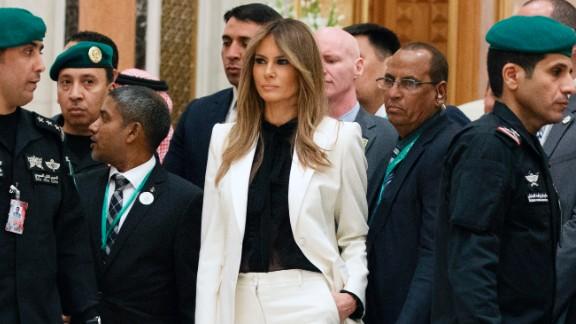 First Lady Melania Trump watches as President Donald Trump poses for photographs with leaders at Arab Islamic American Summit, at the King Abdulaziz Conference Center, Sunday, May 21, 2017, in Riyadh, Saudi Arabia. (AP Photo/Evan Vucci)
