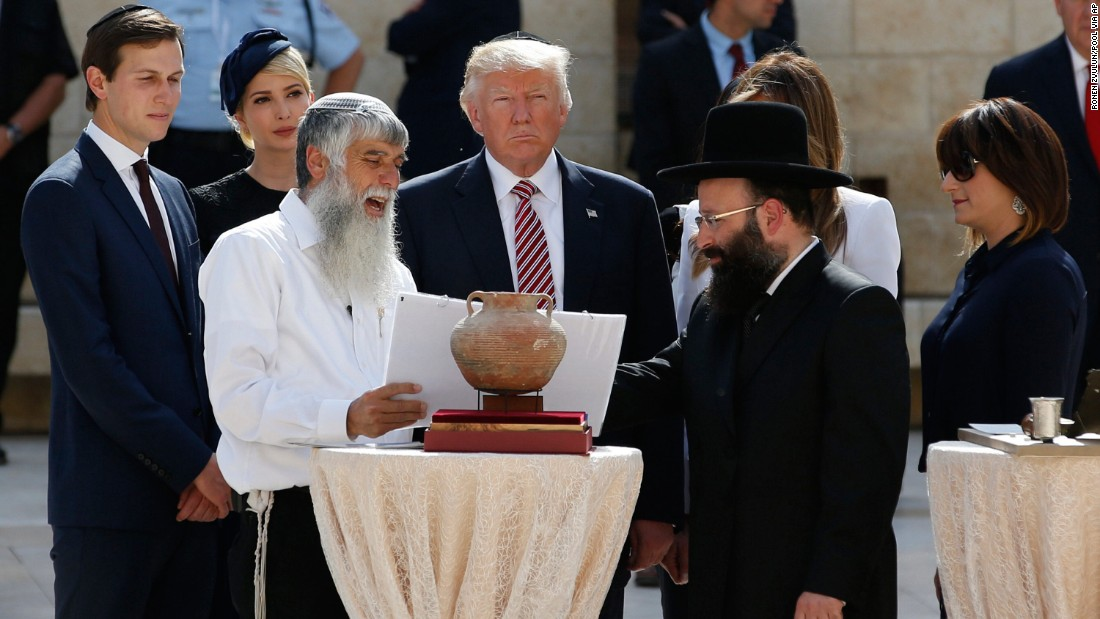 Trump stands in the Western Wall plaza. To his left, in black, is Shmuel Rabinowitz, the rabbi of the Western Wall.