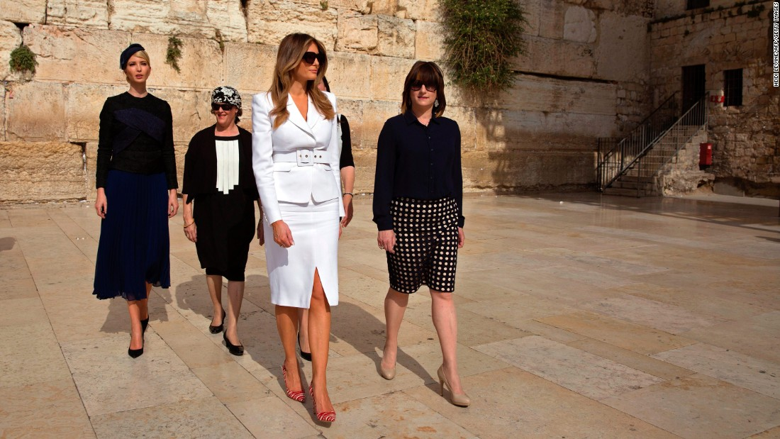 First lady Melania Trump, in white, visits the Western Wall. At far left is Ivanka Trump.