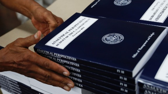 """In this photo taken May 19, 2017, a GPO worker stacks copies of """"Analytical Perspectives Budget of the U.S. Government Fiscal Year 2018"""" onto a pallet at the U.S. Government Publishing Office"""