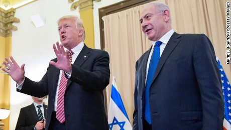 US President Donald Trump (L) reacts to a reporter's question after he and Israel's Prime Minister Benjamin Benjamin Netanyahu spoke to the press ahead of a bilateral meeting at a hotel in Jerusalem on May 22, 2017. / AFP PHOTO / MANDEL NGAN        (Photo credit should read MANDEL NGAN/AFP/Getty Images)