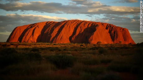 Uluru, a large sandstone formation in central Australia, is sacred to the Indigenous Anangu people and is visited by more than 250,000 people each year.