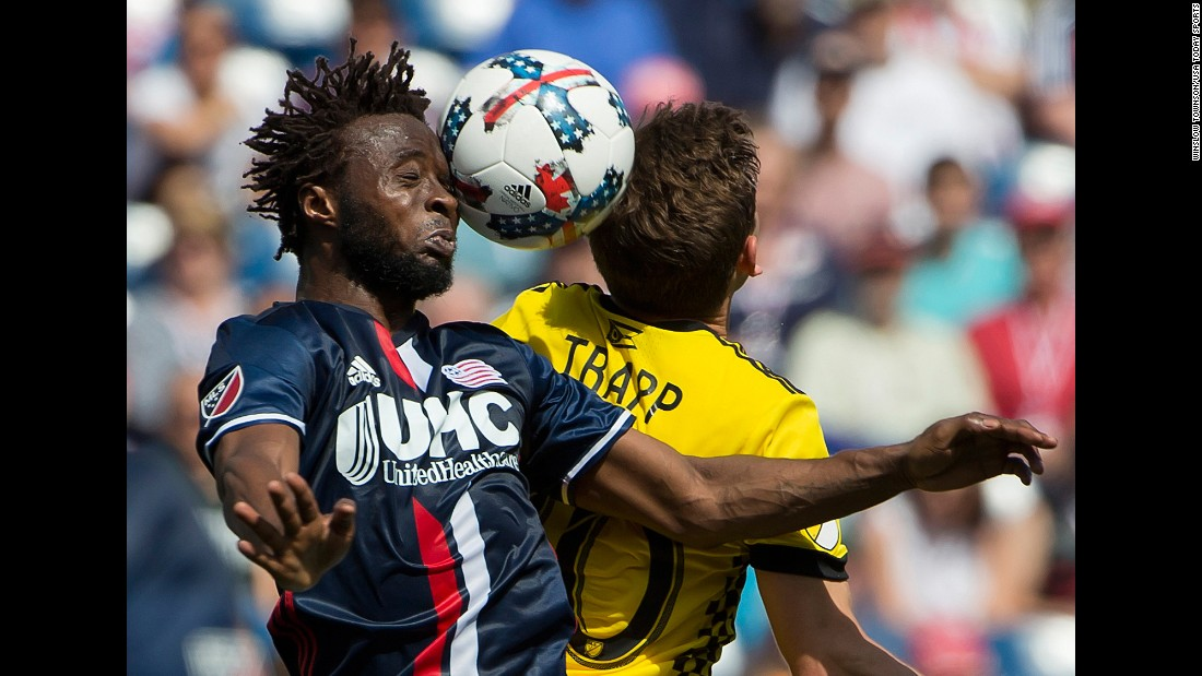 New England midfielder Xavier Kouassi, left, heads the ball during a Major League Soccer match against Columbus on Sunday, May 21.