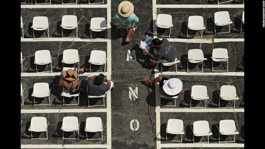 Fans sit in the grandstand before the Black-Eyed Susan Stakes, a horse race at Baltimore's Pimlico Race Course on Friday, May 19.