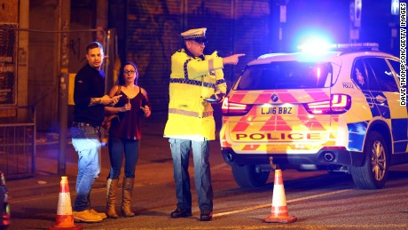 Police stand near a cordoned-off street close to the Manchester Arena on May 22.