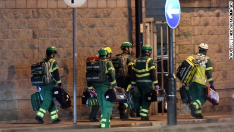 "Medics deploy at the scene of a reported explosion during a concert in Manchester, England on May 23, 2017.  British police said early May 23 there were ""a number of confirmed fatalities"" after reports of at least one explosion during a pop concert by US singer Ariana Grande. Ambulances were seen rushing to the Manchester Arena venue and police added in a statement that people should avoid the area  / AFP PHOTO / Paul ELLIS        (Photo credit should read PAUL ELLIS/AFP/Getty Images)"