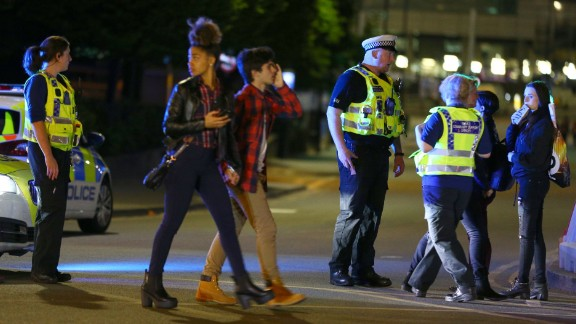 MANCHESTER, ENGLAND - Police and fans close to the Manchester Arena on May 23, 2017 in Manchester, England.  There have been reports of explosions at Manchester Arena where Ariana Grande had performed this evening.  Greater Manchester Police have have confirmed there are fatalities and warned people to stay away from the area. (Photo by Dave Thompson/Getty Images)