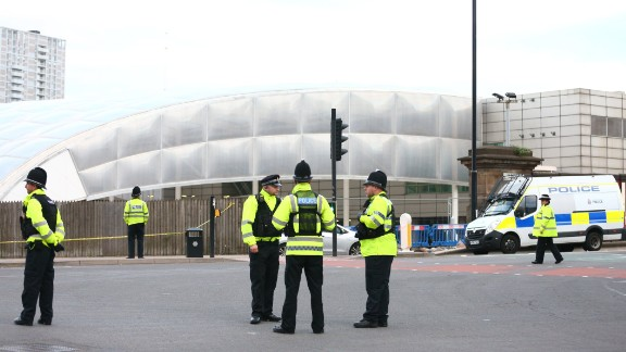 Police officers stand outside the Manchester Arena a day after the bombing there.