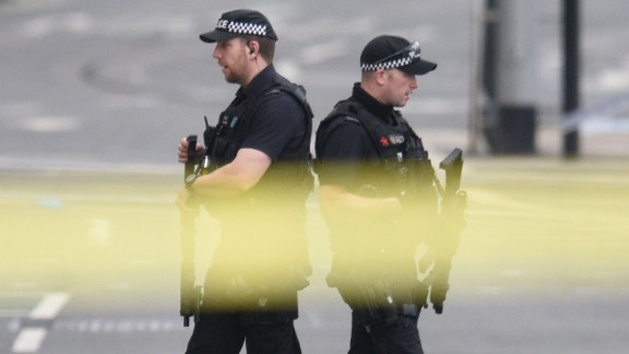 Armed police patrol near Manchester Arena following a deadly terror attack in Manchester, northwest England on May 23, 2017. Twenty two people have been killed and dozens injured in Britain