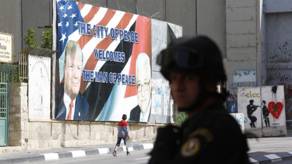 A Palestinian security official takes position before the arrival of Trump