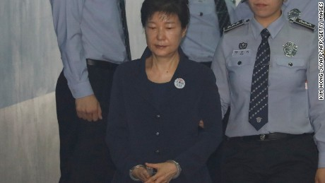 South Korean ousted leader Park Geun-hye arrives at a court in Seoul on May 23, 2017. Park Geun-Hye was due in court on May 23 to face trial over the massive corruption scandal that led to her stunning downfall. / AFP PHOTO / POOL / KIM HONG-JI        (Photo credit should read KIM HONG-JI/AFP/Getty Images)