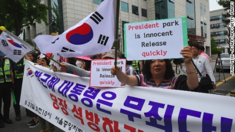 Supporters of South Korea's ousted president Park Geun-Hye gather outside the Seoul Central District Court in Seoul on May 23, 2017 before Park's arrival at the court.