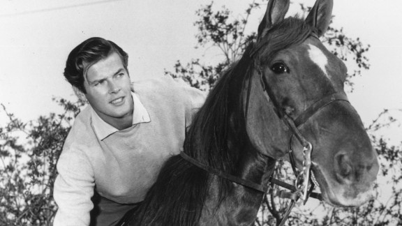 """Moore rides a horse in Hollywood circa 1955. He moved to the United States in 1953 and made his American television debut in the Hallmark Hall of Fame's production of """"Julius Caesar."""""""