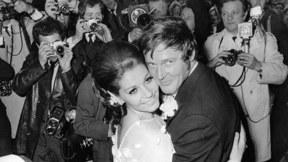 Moore and his third wife, actress Luisa Mattioli, are photographed at their wedding ceremony in 1969.