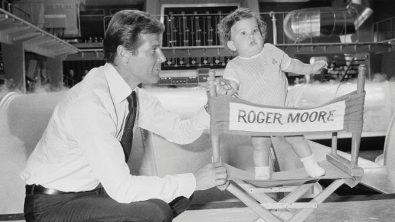 """Moore brings his 1-year-old son, Christian,  on the set of the 1974 film """"The Man with the Golden Gun."""""""
