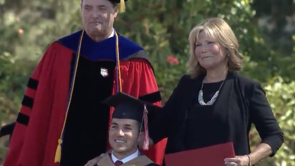 Judy O'Connor and her son Marty pose on graduation day.